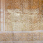 Close up of saree golden weave.